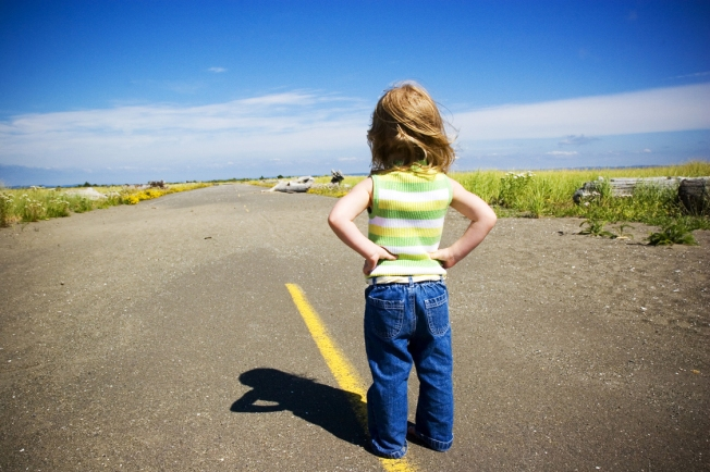 young girl looking down road