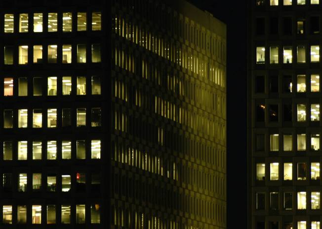 Windows light at night in office block