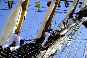 Sailors climb down from the yardarms